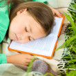 Girl is sleeping on her book outdoors — Stock Photo #50358367