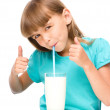 Cute little girl with a glass of milk — Stock Photo #50405843