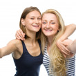 Two young happy women showing thumb up sign — Stock Photo #50570781