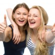 Two young happy women showing thumb up sign — Stock Photo #50574225