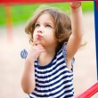 Cute little girl is playing in playground — Stock Photo #50636341