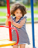 Young girl is playing in playground — Stockfoto