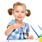 Little girl is painting with gouache — Stock Photo