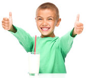 Cute boy with a glass of milk — Stock Photo