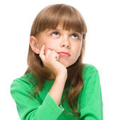 Young girl is daydreaming — Stockfoto