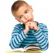 Little boy is tired to read his book — Stock Photo #50790395