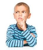 Portrait of a suspicious little boy — Stock Photo
