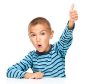 Little boy is showing thumb up sign — Stockfoto