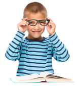 Little boy is reading a book — Stock Photo