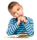 Little boy is tired to read his book — Stock Photo