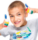 Portrait of a cute boy playing with paints — Photo