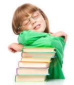 Little girl is sleeping on her books — Stock Photo