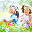 Two little girls are blowing soap bubbles — Stock Photo #51473021