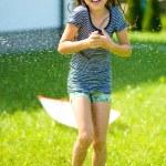 garota feliz é jogando sob chuva — Fotografia Stock  #51511837
