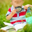 Little boy is reading book — Stock Photo #51511991
