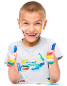 Portrait of a cute boy playing with paints — Stock Photo