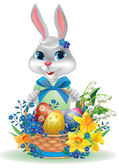 Easter bunny with basket of eggs. — Stock Vector