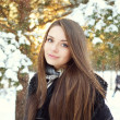 Beautiful woman in winter forest — Stockfoto