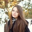 Beautiful woman in winter forest — Стоковое фото