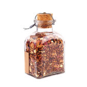 Bottle with dried petals — Stock Photo