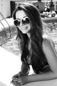 Beautiful girl in pool — Stock Photo