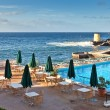 Hotel pool near the atlantic ocean, Madeira, Portugal - Stock Photo