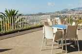 Empty cafe tables high over Funchal city, Madeira, Portugal — Stock Photo