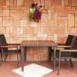 Chairs and table at the wall — Stock Photo