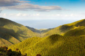 Aerial view to the Atlantic ocean over mountains — Stock Photo