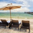 Beach Lounge Chairs with towels under umbrella at the shore of I — Stock Photo #32946591