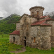 Central Church of Zelenchuksky Churches under heavy sky around the ruins of Nizhnearkhyzskoe gorodishche near Arkhyz, Karachay-Cherkessia, Russian Federation — Stock Photo