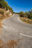 Empty asphalted serpentine mountain road at sunset near Pantokrator, Corfu, Greece — Stock Photo