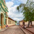 Street with colored buildings in Trinidad, Cuba — Stock Photo #37674583