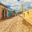 Street with colored buildings in Trinidad, Cuba — Stock Photo #37674587