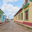 Street with colored buildings in Trinidad, Cuba — Stock Photo #37674589