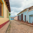 Street with colored buildings in Trinidad, Cuba — Stock Photo #37674591