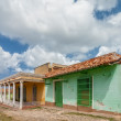Street with colored buildings in Trinidad, Cuba — Stock Photo #37674595