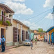 Street with colored buildings in Trinidad, Cuba — Stock Photo #37674599