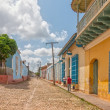 Street with colored buildings in Trinidad, Cuba — Stock Photo #37674603