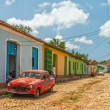 Street with colored buildings in Trinidad, Cuba — Stock Photo #37674615