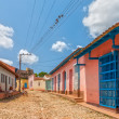 Street with colored buildings in Trinidad, Cuba — Stock Photo #37674619