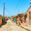 Street with colored buildings in Trinidad, Cuba — Stock Photo #37674629