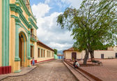 Street with colored buildings in Trinidad, Cuba — Stock Photo