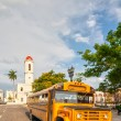 Stock Photo: Old retro yellow school bus parked at Jose Marti park