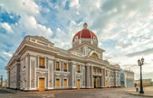 Town hall of Cienfuegos city at Jose Marti park with some locals — Stock Photo