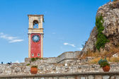 Clock tower at old venetian fortress with old city at background — Stock Photo