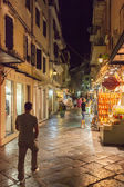 Tourists walking and shopping on narrow streets  — Stock Photo