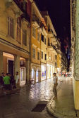 Tourists walking and shopping on narrow streets  — ストック写真