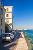 Buildings at embankment of Ionian sea — Stock Photo
