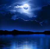 Fantasy Moon and Clouds over water — Stock Photo
